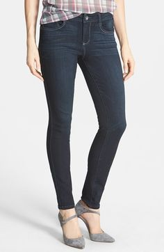 I got these jeans a couple of weeks ago, and they are greatness.  They are a mid-rise jean, they are stretchy, comfy, and tuck very nicely into boots.  And they are UNDER $70!