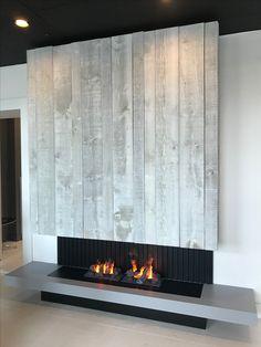 Modern fireplace with grey wood barn finish.