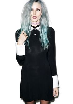 Kill Star Addams Dress cuz we got the club goin' up on a Wednesday! Show off yer darker side with this dress in the style of yer fave emo girl's dress featurin' long sleeves and contrasting cuffs n' collar. Cosplay to yer black heart's content in this dark doll's dress!