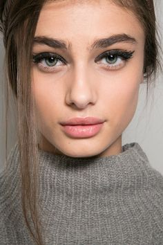 bold brows + cat-eye + muted lip.