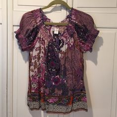 Purple & pink peasant top with beading & sequins! Multi colored paisley peasant top with pretty beading & sequins.  Mostly dusty mauve-purple & purple.  Beading on ends if drawstrings.  Worn only a couple times. Missing a couple beads but not noticeable, reflected in price. Bila Tops Blouses
