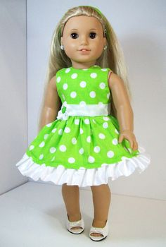 Green Polka Dot American Girl Doll Sun Dress Comes with a Non Slip Head Band and Free Hanger, Fits Most 18 inch Dolls.  This is a very beautiful 100% cotton green polka dot dress, it has a fitted body and a full skirt, a ribbon around waist with a button flower on the side, it ties in the back with Velcro, and has a ruffle around the hemline. It comes with a non slip matching green head band. This dress is a must have for Easter and the upcoming summer months. Most of my pieces are made with…