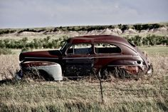 Clunker on Prairie near Pine Ridge Indian Reservation in South Dakota. Abandoned Car in South Dakota.  Stock Photo