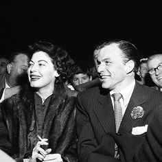Frank Sinatra and Ava Gardner at the Joe Louis-Ezzard Charles fight, more than a year before Sinatra's divorce and their subsequent marriage, September 27th, 1950.