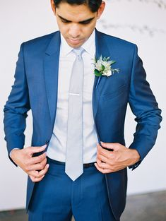 Enchanting Montelucia Wedding elegant blue suit + light blue tie for the groom Blue Suit Grey Waistcoat, Blue Suit Black Tie, Blue Suit Outfit, Blue Suit Men, Blue Suits, Navy Suit Tie, Cobalt Blue Suit, Blue Groomsmen Suits, Blue Tuxedos