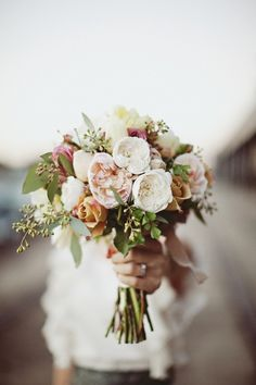 Simple bridal bouquet--I like the seeded eucalyptus & a touch of color