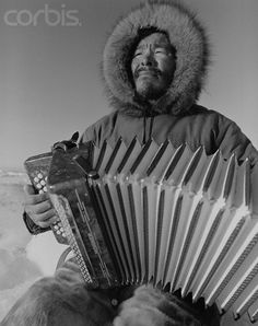 Canadian inuit playing outside ( it must be hard on the skins  inside the instrument)