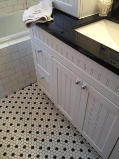 Daltile Octagon and dot tile from Home Depot ... much less expensive ...