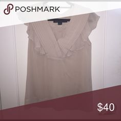 Nude French Connection Top with frilled accents 🌟 Nude French Connection Top with frilled accents 🌟 perfect condition. Size 4.  Sheer in body but not on top (chest area).  Gorgeous top for work or a fancier event. All offers are considered and I offer a bundle discount if you purchase more than one item 😘 French Connection Tops
