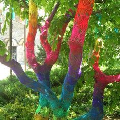 Love this idea...environmental art! Instead of taking out a dead tree, why not paint it!