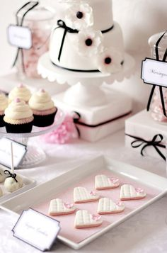 sweet dessert table... Love the boxes to elevate the cake
