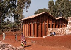 This children's library with rammed earth walls in Burundi, Africa, was built by Belgian studio BC Architects and members of the local community, according to an open-source design template