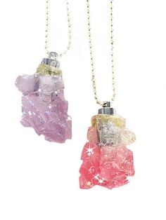 """Rock crystal pendants filled with holographic glitter that light up! Twist the pedant sideways for it to glow. Handcrafted in assorted colors measures 2"""" Handmade in NYC"""