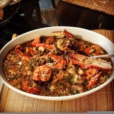okra stew...don't bother with the spoon...you'll ruin the experience...  BN Cuisine With Chef Fregz: Stepping Up My Okro Game  Eba with Seafood Okro (Grilled Catfish, Spicy Prawns, Endless Shrimp)  Looks Yummy! :)    OMG, looks delicious!!