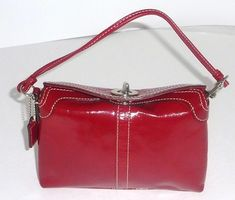 Coach Turnlock Silver Tone Hardware Wristlet in Red
