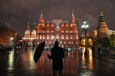 Red Square, Moscow, Russia    On a rainy night in Red Square a man photographs the scene with his camera phone.