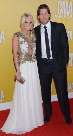 Carrie Underwood & husband Mike Fisher at the 2012 CMA Awards