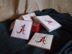 These are plastic canvas coasters for Alabama fans.