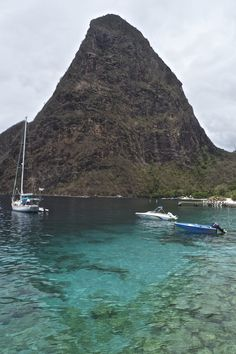 St Lucia's Pitons tower over beaches, fishing villages and flower-speckled rainforest.
