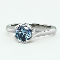 Platinum Cascade Ring set with 0.83 Carat, Round, Very Good Cut, Fancy Intense Blue Color, SI1 Clarity Diamond