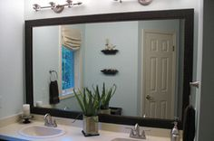MirrorMate frames... this might be an easy solution for updating the huge mirrors in our bathrooms.