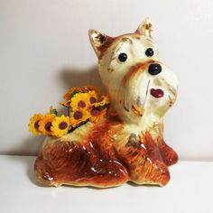 Darling vintage Scottie Dog figurine planter, hes brown with gold gilt accents! Lovely brown and tan with cute eyes and pink tongue! Planter is