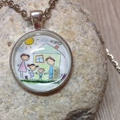 kids drawing into a necklace
