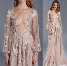 I wonder who this beautiful gown is designed by, would love to know!