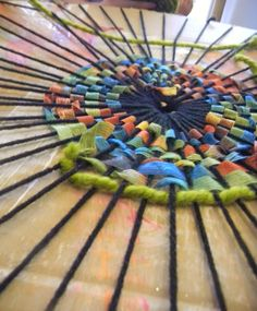 Weaving with rainbow ribbon and yarn. Photo taken by Ray C.