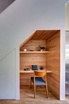 """Three duplex apartments were created in the building, requiring """"new internal stairs connecting each pair of floors,"""" Barker explains. """"All the new stairs had residual space around them, and we worked to find ways to creatively use the space around the stairs. Here, we carved out a little study nook."""" Each family tenant has their own individual """"architectural amuse bouche"""" as a result of the stair design."""