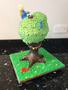 Cherry tree cake constructed using Rice Krispie treats & chocolate for the trunk, cherry & almond cake for the tree canopy & all supported with cake frame. Created to celebrate my sister's 50th birthday- she loves climbing in trees!!!!