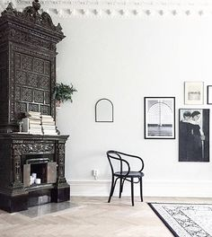 Minimalistiv vintage apartment with magnificent stove and framed posters from printler.com, the marketplace for photo art. Interior design by creamandnavy @ instagram