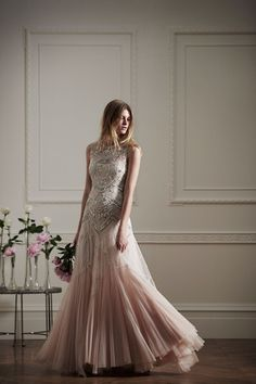 This gown features a delicate beaded bodice and romantic tulle skirt. Needle   & Thread, £350