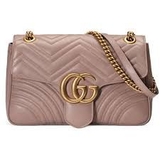 $1,590.00 GUCCI - Gucci GG Marmont Mini Leather Shoulder Bag - Women - SOLD by MYTHERESA - affiliate - Gucci's iconic Marmont silhouette receives a petite update this season. The GG Marmont Mini, expertly crafted in Italy from matelassé leather, is an easy carry option for girls' nights and dinner dates. Notice how the antique gold tone hardware shines next to the petal pink hue. Channel the runway and work yours as part of a bold look.
