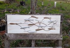This Wood and Galvanized Steel Fish wall hanging would look great on any wall. There are 15 swimming minnows mounted on a salvaged piece of white wood. Measure approx. 32 wide X 11 1/2 tall. If you want us to create you one with different colors just look thru the colors in our color