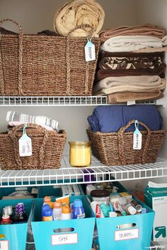 Utilize the power and style of baskets for linen closet organization. Love those tags! // Via modish and main