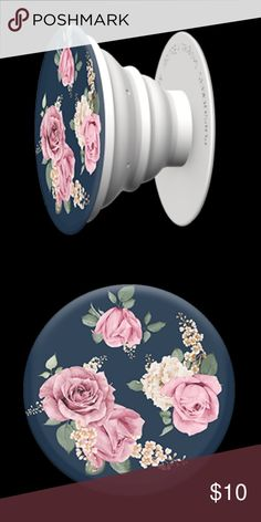 "SALE!! Vintage Perfume PopSocket ❤️❤️ Add a single PopSocket, or a pair of PopSockets, to the back of almost any mobile device to transform its capabilities. PopSockets ""pop"" whenever you need a grip, a stand, an earbud-management system, or just something to play with. This super cute PopSocket features a navy background with pink roses giving it a vintage look. Limited Quantities! PopSockets Accessories Phone Cases"