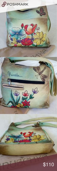 """🌼Anuschka Leather Bag🌼 Barely used! In great shape! Hand painted and one of a kind. 10"""" H x 11"""" L x 3.3"""" D. This is authentic and kept in the dust bag which is included. End to end main zipper compartment boasts 2 zipperd pouches and 2 open pouches. 2 snapped  areas on both sides. Another zippered pouch in back and a 4"""" pocket. Double straps are 26"""". The hardware looks a bit tarnished on the straps. Such a soft leather. It just gets better with age. Anushka Bags"""