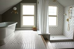 Subway tile and brass shower