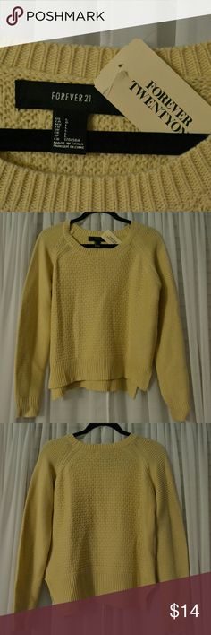 Light Yellow Cropped Sweater Yellow Cropped Sweater that will keep you warm all summer and winter. Back side is longer in length than the front. Length is waist length. Never worn and still has all original tags! Can be bundled with anything! Forever 21 Sweaters