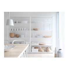 add baskets, magazine files, decor, dishes and...voila, you have super cute kitchen shelving