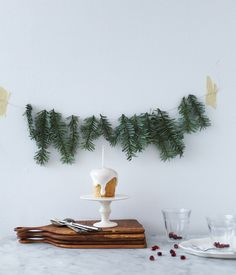 If your table is near the wall, how about making or buying a lovely garland or bunting. Making a wall feature is such a easy way to bring a festive feel if you don't want to clutter up the table with decorations or if you have a smaller table.