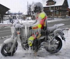 #Caption this picture - #Biker and #motorbike frozen in ice