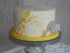 Sweet yellow and gray elephant baby shower cake. The elephants are hand-cut to match the invitations. Elephant Baby Shower Cake, Baby Shower Yellow, Baby Shower Fall, Baby Elephant, Baby Shower Cakes, Baby Cakes, Christening Decorations, Birthday Decorations, Birthday Ideas