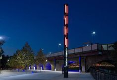 Cornmill Gardens is a new open space for Lewisham Town Centre, London. The signage strategy introduces two simple sign types. Tall markers located at arrival thresholds identify and map, and pedestrian directional blades assist circulation.