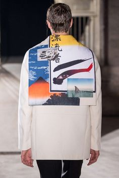 "Raf Simons S/S 2015 at PFW ""On the back of most of the coats and jackets in his collection were sailor collars collaged with fragments of his personal history—the actual and the imagined. 'Like mood boards you'd pin your favorite images to,' he said. Friends, family, a fluffy kitty, a roller coaster, Mt. Fuji painted by Hokusai, a koi pond, a shark, a swimmer in peril, an astronaut…it seemed furiously random until Simons parsed the images."" via"