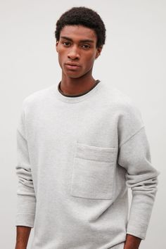 COS image 7 of Relaxed wool jumper with pocket in Light grey