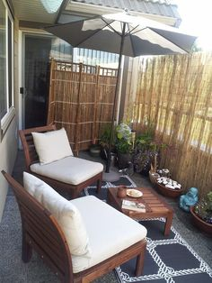 My personal balcony retreat with reed privacy screen.                                                                                                                                                                                 More