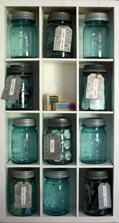 Old jars in shelf.  Thinking of doing this for odds and ends in the sewing studio.