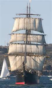 This is a barque (I think she is a barque) called the James Craig. She was found as a hulk, and has been restored to her former glory by volunteers over many years.